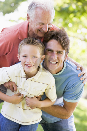 Grandfather with adult son and grandchild in park stock photo,  by Monkey Business Images