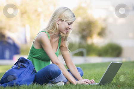 University student using laptop outside stock photo, Female university student using laptop outside by Monkey Business Images