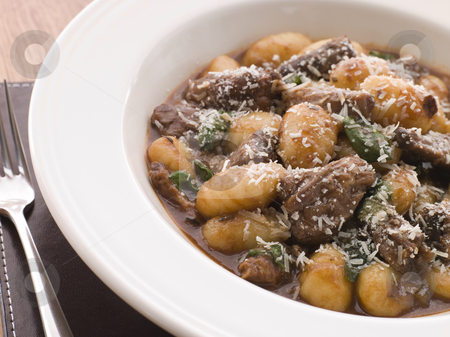 Oxtail Braised in Red Wine with Basil Gnocchi and Parmesan Chees stock photo,  by Monkey Business Images