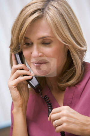 Consultant phoning client with good news stock photo, Consultant phoning client from surgery with good news by Monkey Business Images