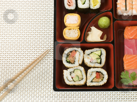 Selection of Sushi In a Bento Box stock photo, Selection of Sushi In a Bento Box with chopsticks by Monkey Business Images