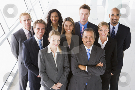 Overhead view of office staff stock photo, Overhead view of office staff looking to camera by Monkey Business Images
