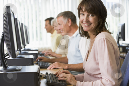 Adult students in a computer lab stock photo,  by Monkey Business Images