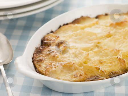 Dish of Dauphinoise Potatoes stock photo,  by Monkey Business Images