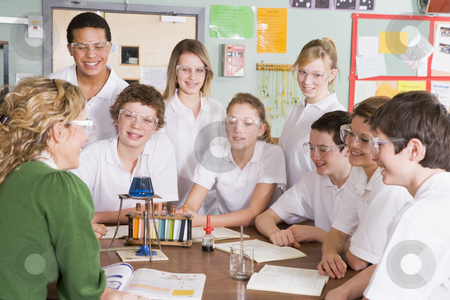 Schoolchildren and teacher in science class stock photo,  by Monkey Business Images