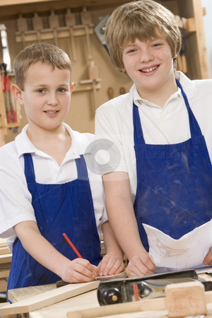 Schoolboys in woodwork class stock photo,  by Monkey Business Images