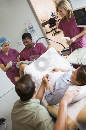 Doctor retrieving eggs from ovary using ultrasound stock photo, Doctor retrieving eggs from ovary using vaginal ultrasound by Monkey Business Images