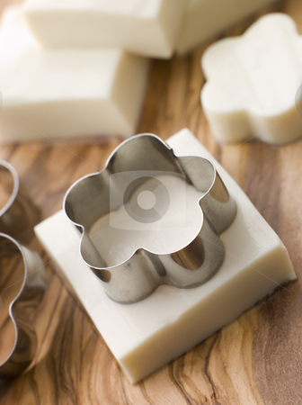 Firm Tofu on a Chopping Board stock photo, Firm Tofu on a Chopping Board with shape cutter by Monkey Business Images