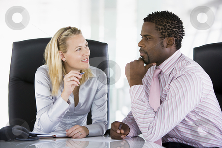 Two businesspeople in office talking stock photo,  by Monkey Business Images