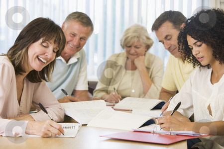 Adult students studying together stock photo,  by Monkey Business Images