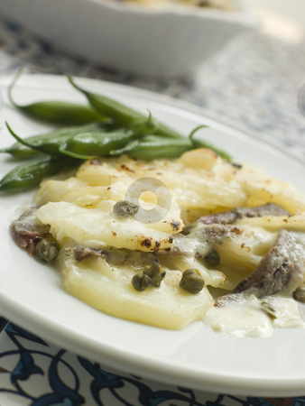 Spanish- Style Potato Gratin with Green Beans stock photo,  by Monkey Business Images