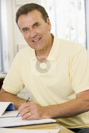 Male adult student studying on campus stock photo,  by Monkey Business Images