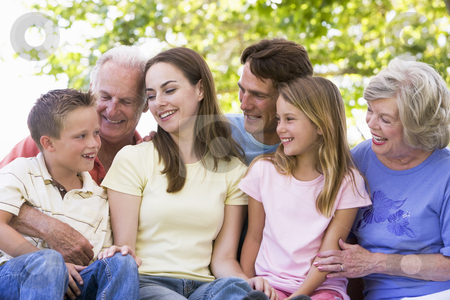 Extended family outdoors smiling stock photo,  by Monkey Business Images