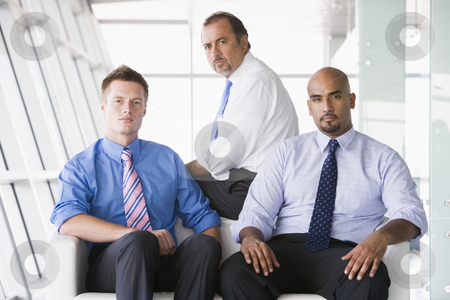 Group of businessmen sitting in lobby stock photo, Group of businessmen sitting in office lobby by Monkey Business Images