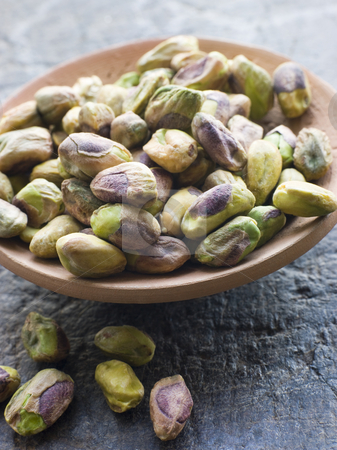 Dish of Pistachio Nuts stock photo, Close up Dish of Pistachio Nuts by Monkey Business Images