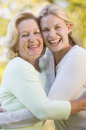 Mother hugging grown up daughter stock photo,  by Monkey Business Images