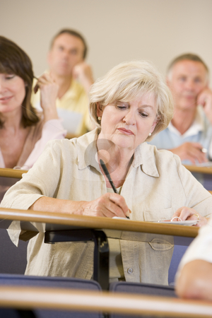 Senior woman listening to a university lecture stock photo,  by Monkey Business Images