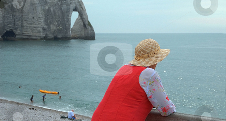 Old woman at seaside stock photo,  by Midas Mould