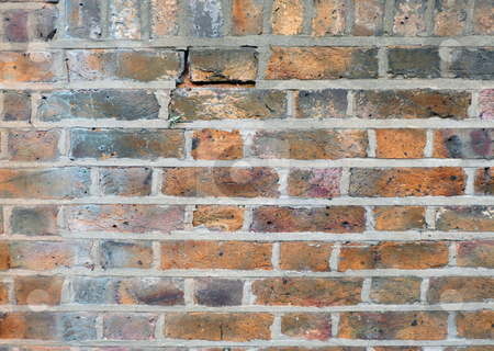 Old wall stock photo, Weather old brick wall with mortar missing and falling down by Michael Travers