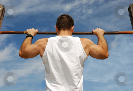 Reaching Goal stock photo, Reaching Goal: Strong Man Doing Pull-ups on a Bar in a Park by Denis Radovanovic