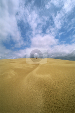 Man in the distance running across sand flats,  stock photo,  by Monkey Business Images
