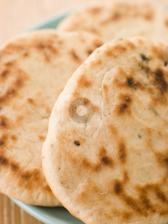 Plate of Plain Naan Breads stock photo,  by Monkey Business Images