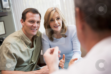 Couple in consultation at IVF clinic  stock photo, Couple in consultation at IVF clinic talking to physician by Monkey Business Images