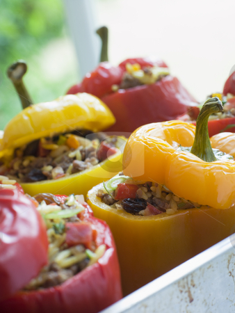 Bell Peppers stuffed with Spiced Rice and Dried Fruits stock photo,  by Monkey Business Images
