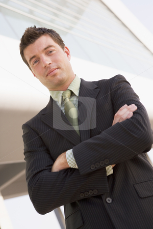 Businessman standing outdoors by building stock photo,  by Monkey Business Images