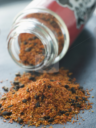 Shichimi Togarashi Pepper stock photo, Jar of Shichimi Togarashi Pepper spilling out by Monkey Business Images