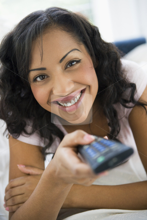 A South American woman watching television stock photo,  by Monkey Business Images