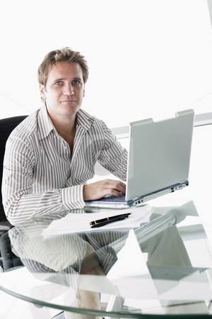 Businessman in boardroom with laptop stock photo,  by Monkey Business Images