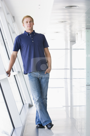 Man standing in corridor stock photo,  by Monkey Business Images