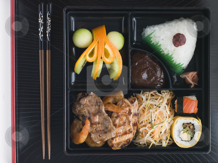 Teppanyaki Lunchbox with Chopsticks stock photo, Overhead shot of Teppanyaki Lunchbox with Chopsticks by Monkey Business Images