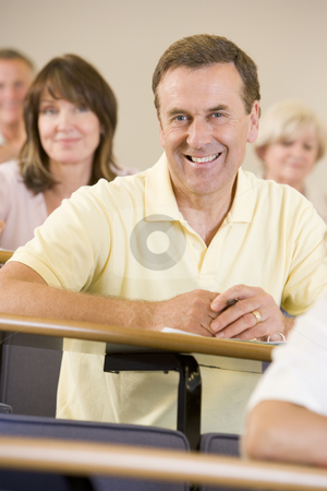 Male adult student listening to a university lecture stock photo,  by Monkey Business Images