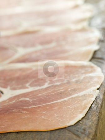 Slices of Serano Ham stock photo,  by Monkey Business Images
