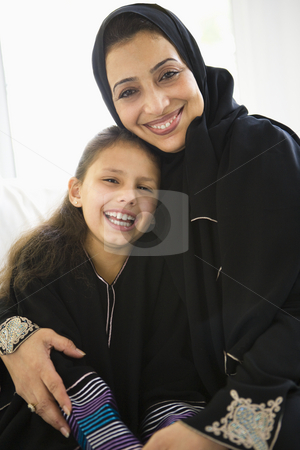 A Middle Eastern woman with her granddaughter stock photo,  by Monkey Business Images