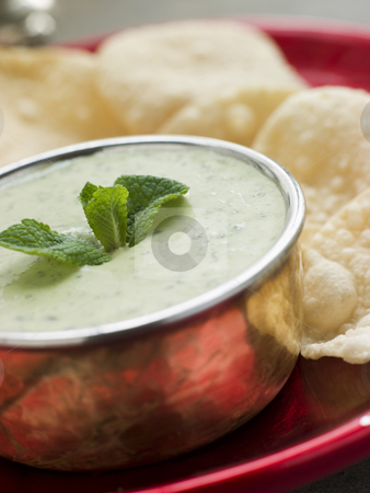 Fresh Green Yoghurt Chutney with mini Papadoms stock photo, Plate of Fresh Green Yoghurt Chutney with mini Papadoms by Monkey Business Images