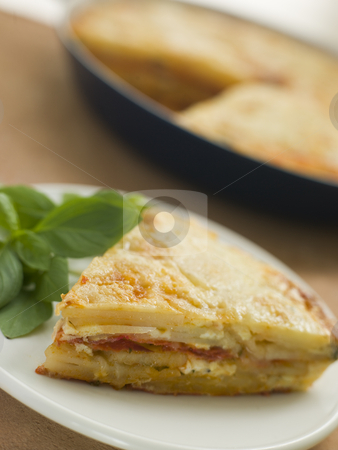 Spanish Potato and Chorizo Sausage Omelette stock photo,  by Monkey Business Images