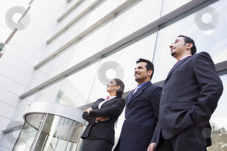 Group of business people outside office stock photo, Group of business people outside modern office by Monkey Business Images