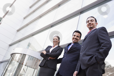 Group of business people outside office building stock photo, Group of business people outside modern office building by Monkey Business Images