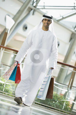 A Middle Eastern man in a shopping mall stock photo,  by Monkey Business Images
