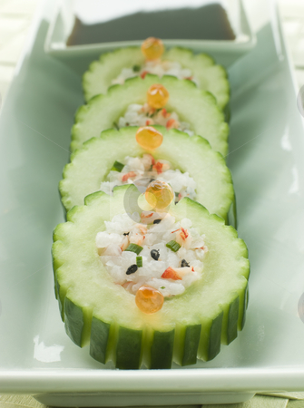 Cucumber Sushi Roll with Crayfish and a Soy Dip stock photo, Plate of Cucumber Sushi Roll with Crayfish and a Soy Dip by Monkey Business Images
