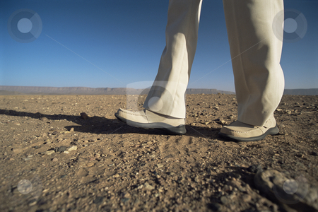 Man walking in desert, low section, ,  stock photo,  by Monkey Business Images