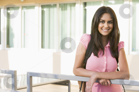 Female student on campus stock photo, Female student on university campus by Monkey Business Images