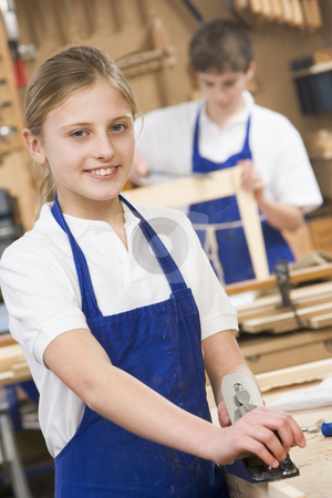 Schoolgirl in woodwork class stock photo,  by Monkey Business Images