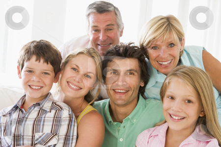 Family indoors together smiling stock photo,  by Monkey Business Images