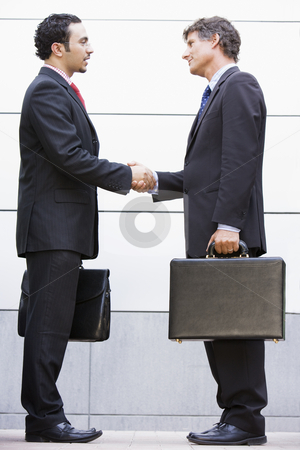 Businessmen meeting outside office stock photo, Businessmen meeting outside modern office by Monkey Business Images