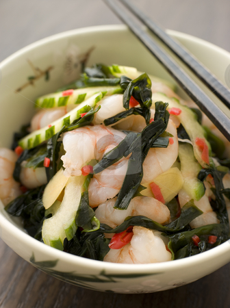 Tiger Prawn Wakame and Cucumber Salad with Ginger stock photo, Bowl of Tiger Prawn Wakame and Cucumber Salad with Ginger by Monkey Business Images