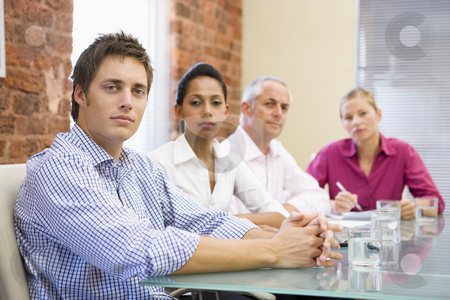Four businesspeople in boardroom stock photo,  by Monkey Business Images